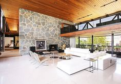 Clinton Residence by Maxime Jacquet. (Amir Farr was the architect).  Love the 70's modern ski chalet feel.  Those ceilings!