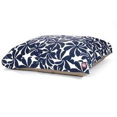 """Rectangular pet bed in navy blue floral.Product: Pet bedConstruction Material: Polyester cover, polyfill and waterproof baseColor: Navy blueFeatures: Zippered slipcoverOutdoor treated polyester with up to 1000 hours of UV protectionWaterproof 300/600 denier fabric baseDimensions:   Small: 4"""" H x 36"""" W x 29"""" D   Medium: 5"""" H x 44"""" W x 36"""" D   Large: 5"""" H x 50"""" W x 42"""" D     Cleaning and Care: Machine wash warm and tumble dry low"""