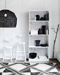 Embolden Shelving | Martha Stewart Living - Skinny zigzag lines are the recurring theme in this nook, where an oversize rattan pendant echoes the rug. But the clincher? A basic IKEA bookcase turned one-of-a-kind display.
