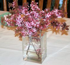 Simple spring centerpiece. Flowering crab branches.