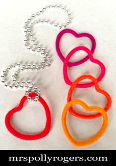 Click here to DIY 5 Heart Necklaces for 2 DOLLARS & scraps of yarn!!  Great GIFT!  Blog & Photos from MrsPollyRogers.com