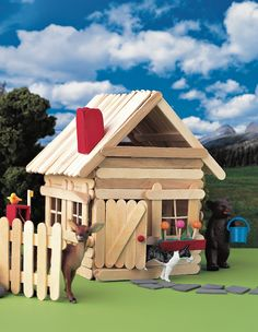 Popsicle Stick Cottage: Toy animals roam free at this rustic popsicle stick cabin.