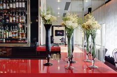 Creative Restaurant Interior Design with Unique Decoration:Glossy Red Table Furniture And Glass Bud Vases Plus Classic Violet Chairs In Restaurant