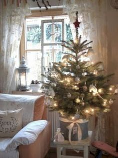 I love short and full at the bottom Christmas trees! A simple but beautiful Christmas tree. Powder blue lantern in the window.