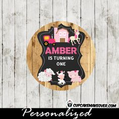 Printable girl farm birthday favor tags or cupcake toppers personalized for you! The custom farm animals themed tags feature a pink barn, a tractor and the sweetest farm animals against a chalkboard backdrop on printed barn wood. #cupcakemakeover