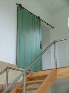 Barn architecture staircase contemporary home renovations with green barn door cable railing