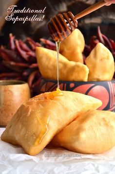 Authentic light and fluffy New Mexico Sopaipillas (So-pa-pe-ya). I always bite off the corner and drizzle honey inside! Can be an appetizer, main course (stuffed) or even a dessert dusted with confectioner's sugar!