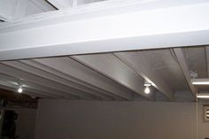 How to Paint a Basement Ceiling with Exposed Joists for an Industrial Look