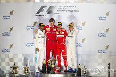 Podium: winnaar Sebastian Vettel, Ferrari, tweede plaats Lewis Hamilton, Mercedes AMG F1, derde plaats Valtteri Bottas, Mercedes AMG F1