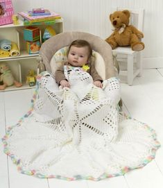 Doily Baby Blanket in Red Heart Soft Baby Steps Solids - LW2487. Discover more Patterns by Red Heart Yarns at LoveKnitting. The world's largest range of knitting supplies - we stock patterns, yarn, needles and books from all of your favorite brands.