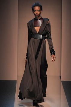 I find the whole Gianfranco Ferre collection one of the most exciting things I've seen in fashion in a while. wearable, rugged, luxurious, infused with this warrior thing and the way those belts are looped. LOVE it