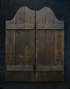 Bad-ass set of saloon doors unlike any you've seen before. Handcrafted in my studio of reclaimed lumber and given an incredibly distressed finish as though they saw the worst of the Wild West, and took it in stride. The wood has incredibly raised grain as though weathered for 100 years. Soft-sheen protective polyurethane finish. Hand forged iron nail heads and real iron horseshoe accents complete the dramatic effect. They come with a brand new set of swinging brass hinges (not shown) for…