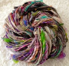 150 Yds of Art Yarn Love! I spun from one of my Chunky Art Batts-   Contents: Teeswater, Mohair, Wenslydale, Wool, Punta, Angelina, Tencel, Silk, Firestar...and whatever else I threw in