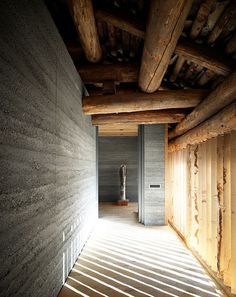 Love the mix of smooth concrete, raw solid oak wood and hand- treated welded steel in this Swiss barn conversion by Ruinelli Associati Architetti.