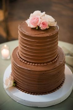 Simple wedding cake idea - two-tier, chocolate wedding cake with buttercream frosting + pink, flower cake toper {Elizabeth Nord Photography, LLC}