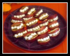 Now serving...mouth. Apples, Peanut Butter and Marshmallows make fun Halloween party food. -Momo