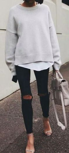 street style. jumper over blouse. ripped skinny jeans. strappy sandals.