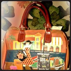 Authentic Nicole Lee Vacation Patchwork Satchel Faux leather with patchwork vacation scene, double handle, top closure, zippered pocket on back, detachable, adjustable strap, Nicole Lee satin lining. Nicole Lee Bags Satchels