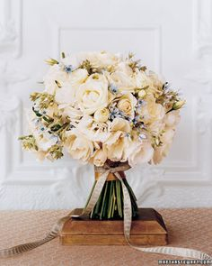 Love this rustic looking bouquet. Maybe coral or teal instead of blue? I like the little blue flower which could be added to bouquet and used for boutineer.