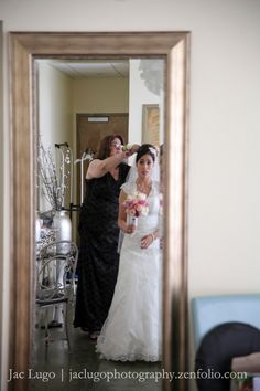 My mom pinning my veil..