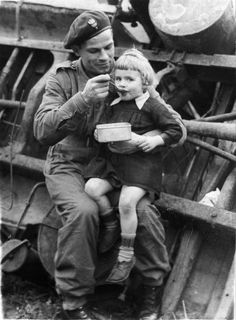 A soldier of the Polish Armoured Division feeds a little Dutch girl, near the city of Tilburg, October Italian Campaign, Hungry Children, North Africa, Armed Forces, World War Two, North West, Retro, Troops