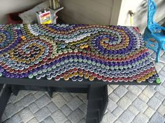 How To Make A Bottle Cap Mosaic Table  ...............Follow DIY Fun Ideas at www.facebook.com/... for tons more great projects!