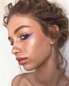 Bronzed skin, nude lip with a purple pop of coloured liner. Would you give this look a try?