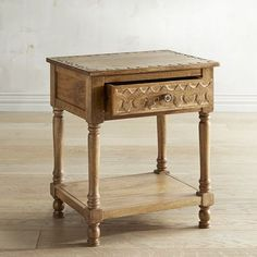 Beautifully carved and detailed, our mango wood Sakandi Accent Table is a spectacular specimen of global artisanship. The natural finish showcases the rich, variegated grain. Let it bask in the limelight.