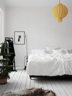 Minimal, monochrome with an unexpected pop of yellow. #bedroom