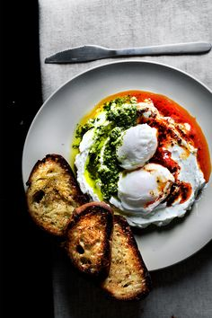 HELLO, ÇILBIR. Turkish poached eggs on garlic yogurt, with Aleppo butter and pickled chili chimichurri.