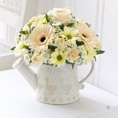 Little Duckling Watering Can Cream.  For something a little different, send your best wishes with this charming arrangement. The decorative watering can has a sweet #baby duckling design and looks stunning filled with fresh flowers in shades of cream, white and peach. Adorable – just like their new arrival!