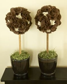 this is pretty much what i had in mind, except using moss or other greenery instead of burlap.