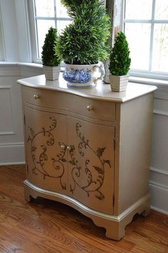 cabinet makeover with martha stewart metallic paint, painted furniture, Used MS Metallic in Golden Pearl and painted around the leaf and vine motif Metallic Painted Furniture, Metal Furniture, Repurposed Furniture, Diy Furniture, Painted Dressers, Painting Furniture, Martha Stewart Metallic Paint, Restoration Hardware Outdoor Furniture, Shabby Chic Bedroom Furniture