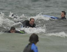 Prince William seen here with pals having the time of his life at the Cornwall beach. Image: INS News / July 8, 2012