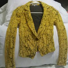 Flower Blazer Bought it because I liked it tried it on did not fit has a little strip on the side but very fixable not noticeable under the arm area as reflected the price Charlotte Russe Jackets & Coats Blazers
