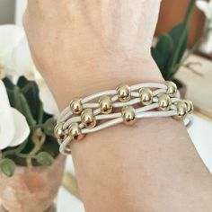 Leather and Gold Bead Bracelet for Women made with ivory color leather and gold beads. This is a great bridesmaid gift or just a cool summer bracelet to wear anytime. #leatherbracelets #ivoryleatherbracelet #braceletsforwomen
