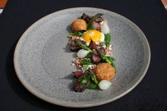 Chef Wesley / Lahaina, HI - Brandt beef hanger, neighborhood farm egg, bacon powder, parm croquettes