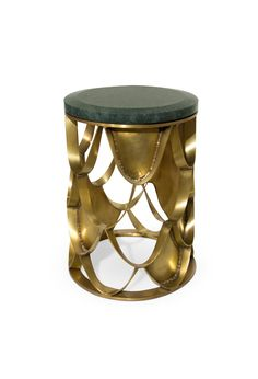 Modern Side Table KOI is a round and small side table with a brushed brass base and a green and black marble top.