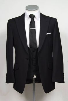 """black grooms wedding suit slim fit light weight wool with scoop neck waistcoat. Mens sizes from 32"""" chest upward and include extra short, short, regular, long and extra long fittings. Boys sizes from 20"""" to 34"""" chest. Complete outfit includes jacket, skinny trousers, hire or matching waistcoat, brand new traditional or French wing slim fit shirt in white or ivory, tie or cravat, braces and cufflinks. £150.00 to hire groom wedding suit black"""