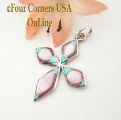 Four Corners USA Online - Turquoise and Pink Mother of Pearl Inlay Cross in Sterling Silver Native American Indian Zuni James Kee NACR-1414, $49.00 (http://stores.fourcornersusaonline.com/turquoise-and-pink-mother-of-pearl-inlay-cross-in-sterling-silver-native-american-indian-zuni-james-kee-nacr-1414/)