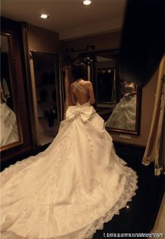 Princess dress for sure, dont like the bow but the long train is beautiful