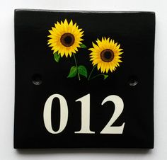 House Number Sign with Sunflowers Hand painted ceramic house number signs with paintings of birds, flowers, trees, animals and more. See our picture choices www.handpaintedhousesigns.co.uk