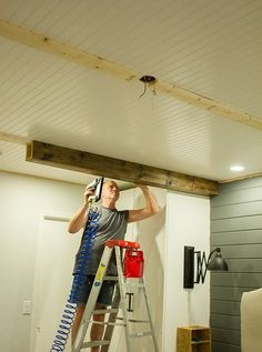 FAKE BEAMS FOR RACEWAY - LEAVE GAP FOR CEILING BOX -- http://blog.jennasuedesign.com/2014/07/master-makeover-diy-wood-beams/
