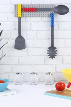 Like putting geeky gadgets into your kitchen? If so, you'll absolutely LOVE this LEGO-style 3 piece cooking block utensil set from DOIY Design. When you're done using them, simply snap their brick handles onto the gray base plate that hangs on the wall. #home #kitchen #cooking #lego