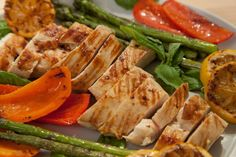 This flavorful chicken is a breeze and healthy! Marinated with garlic, basil, lemon and red pepper and then grilled perfectly. Serve with grilled veggies!