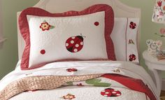 Ladybug girls bedding set with bright patterns of red and black lady bugs on a white background