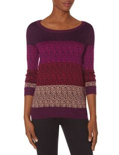 Like the various colors throughout the sweater. Plus sleeve length :)