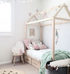 bed frame around bed in a house shape