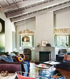 Spanish farmhouse with soulful vintage style // pillows and fireplace