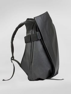 Black Côte et Ciel Isar backpack in coated canvas and leather.